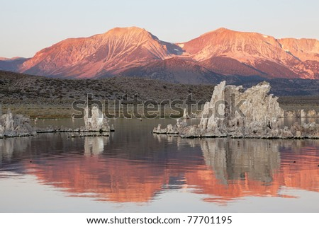 Fabulous sunrise. Sunrise at Mono Lake in the crater of an ancient extinct volcano. The lake is a lot of beautiful reefs Tufa - stock photo