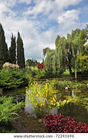 Fabulously beautiful park-garden Sigurta. Ornamental pond and colorful flowers and trees - stock photo