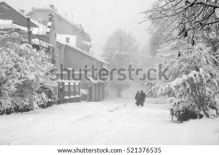 Fabulously beautiful winter with snow on the trees and deep snow drifts. Silhouette of man and woman in the winter