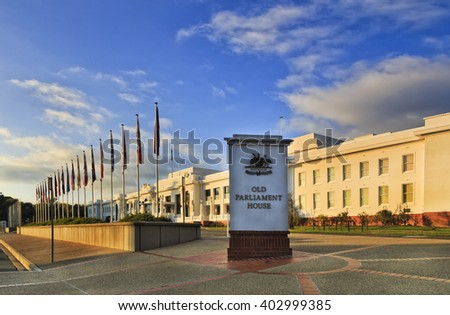 Facade and entrance to the Old Parliament house in Canberra as seen from side at sunrise. Historic provisional government building for Australians. Public building without restriction for access. - stock photo