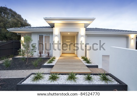 Facade and entry to a contemporary white rendered home in Australia - stock photo