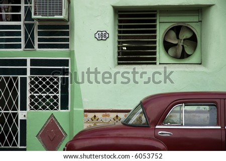 Facade and oldtimer in Old Havana - stock photo