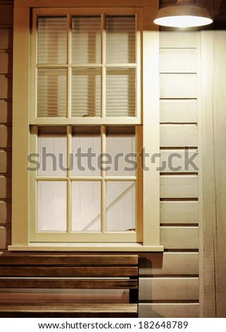 Facade building window and  street lamp light at night - stock photo