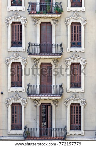 Facade of a building with balcony and windows in old house