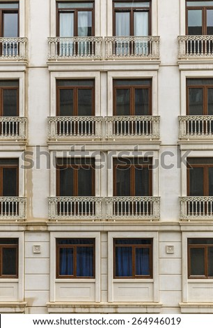 Facade of a building with windows and balconies - stock photo