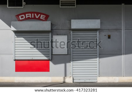 Facade of a closed drive-through ordering restaurant - stock photo