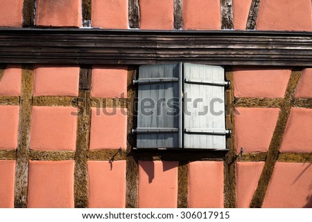 Facade of a half-timbered house in Alsace - stock photo