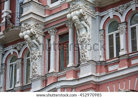 Facade of a historic building with statues. Kiev, Ukraine - stock photo