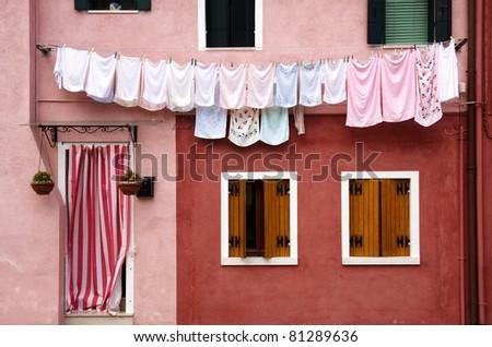Facade of a house in Burano near Venice - stock photo