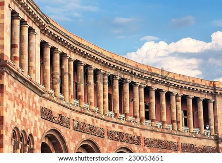 Facade of a massive building with galleries, columns and balconies - stock photo