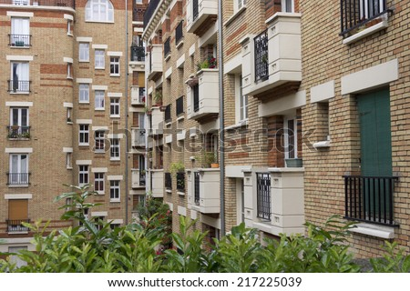 Facade of a modern apartment building in Paris, France - stock photo