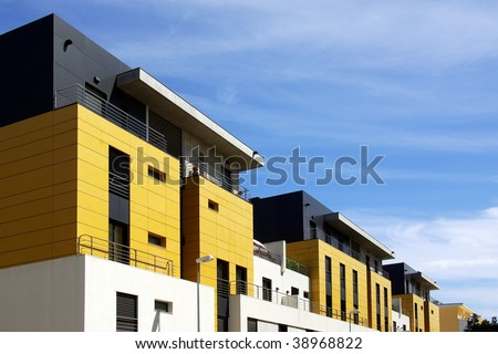 Facade of a modern apartment condominium in a sunny day - stock photo