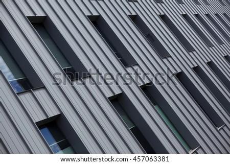 Facade of a modern building in town - stock photo