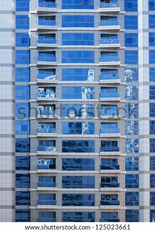 facade of a modern high-rise building - stock photo