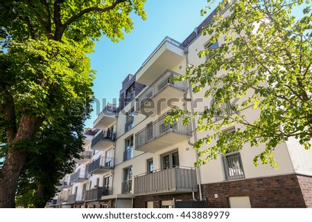 Facade of a modern residential building in the city - stock photo