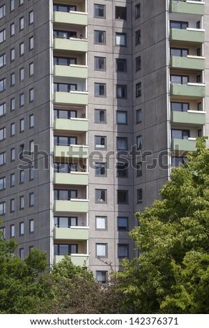Facade of a modern urban apartment building - stock photo
