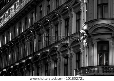 Facade of a old tradition building with many windows - black and white. - stock photo