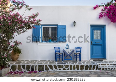 Facade of a small house in Antiparos island, Greece - stock photo
