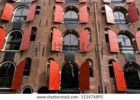 Facade of a traditional house in Amsterdam - stock photo