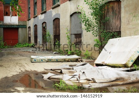 Facade of an abandoned building full of  broken windows and closed windows - stock photo