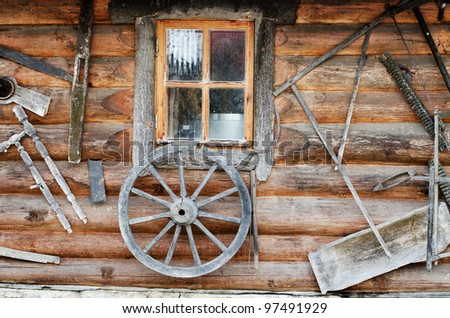 Facade of an ancient wooden log hut - stock photo