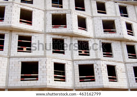 Facade of an apartment house under construction