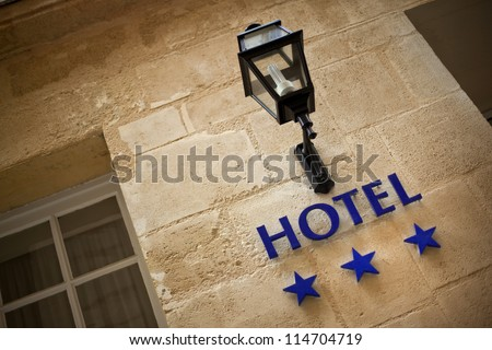 Facade of an hotel in France - stock photo