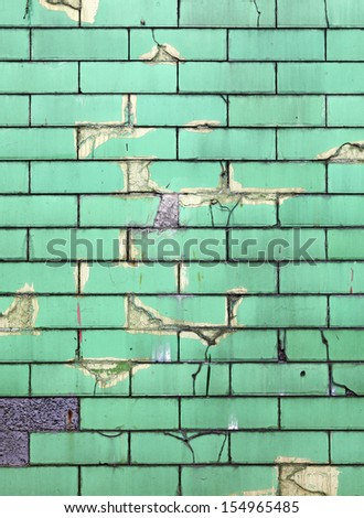 Facade of an old cracking green ceramic tile wall for textural background.  - stock photo