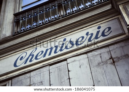 Facade of an old fashion store in France - stock photo
