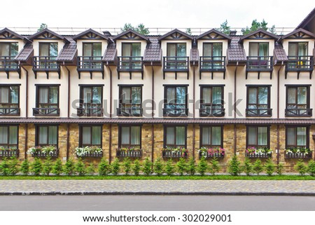 facade of an old-fashioned building with beautiful surroundings - stock photo