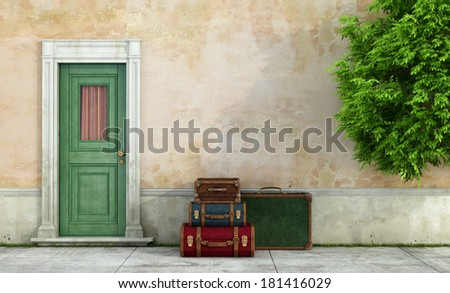 Facade of an old house with  vintage suitcases near the door - rendering - stock photo