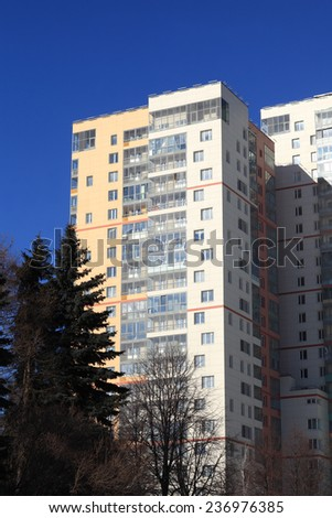 Facade of apartment building on the sky background - stock photo