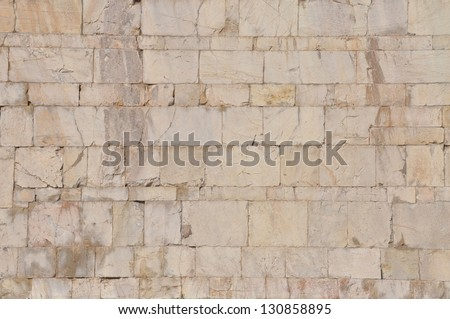 Facade of building, the stone wall background - stock photo