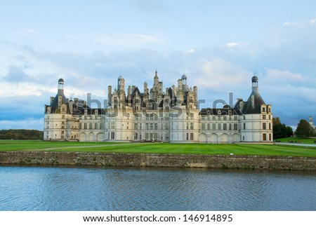 facade of Chambord chateau at sunset, Pays-de-la-Loire, France - stock photo