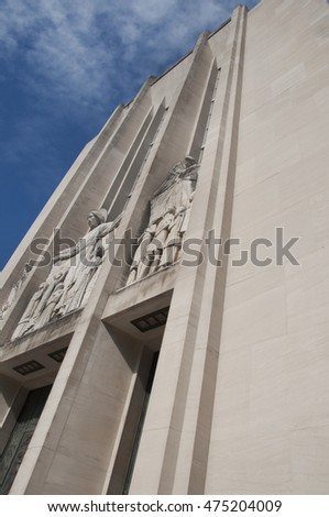 Facade of church looking up at relief architectural sculpture.
