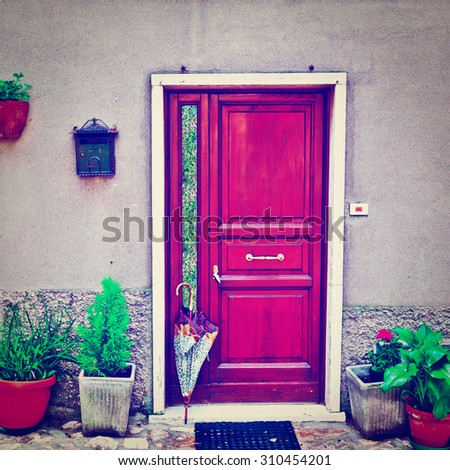 Facade of Italian House Decorated with Fresh Flower, Instagram Effect - stock photo