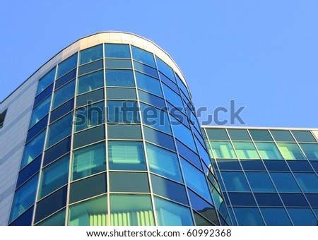 Facade of office building on a background lightblue sky - stock photo