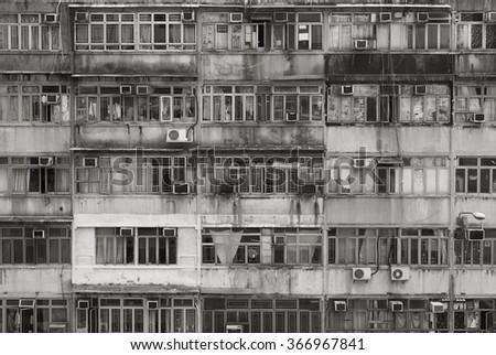 Facade of old apartment building in Hong Kong - stock photo