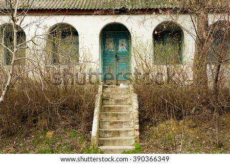 Facade of old destroyed house with broken windows. Old Abandoned House - stock photo
