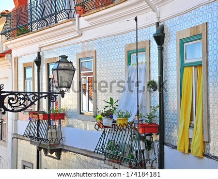 Facade of old house in Alfama district, Lisbon - stock photo