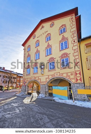 Facade of one of the houses in Garmisch-Partenkirchen, Germany. The Bavarians have a long history of decorating the exteriors of their houses and businesses with both religious and historic paintings - stock photo