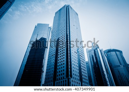 Facade of skyscrapers, low angle view,blue toned image. - stock photo