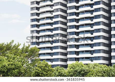 Facade of tall building full of apartments in city - stock photo