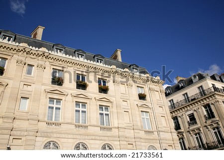 Facade of the big ancient house in Paris - stock photo