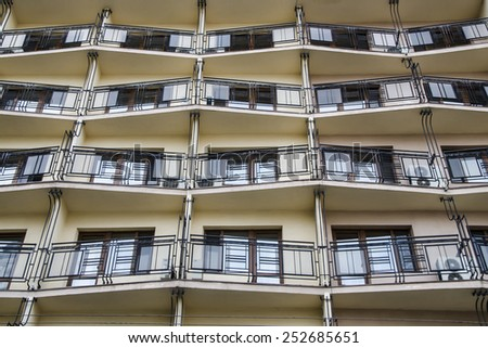 facade of the building with balconies - stock photo