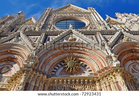 Facade of the Cathedral of Siena in Tuscany / Italy