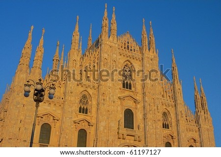 Facade of the Duomo in Milan during the afternoon, Italy - stock photo