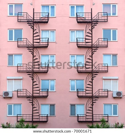 facade of the house with fire safety stairs - stock photo