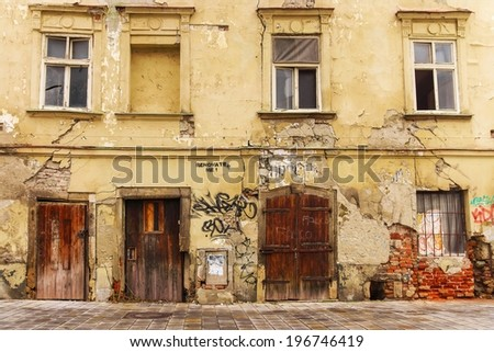 facade of the old dilapidated house - stock photo