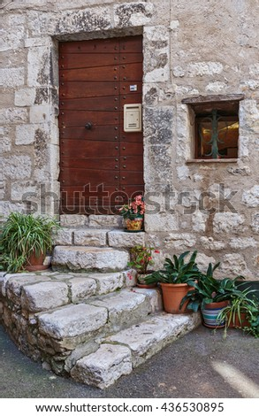 Facade of the old house in France - stock photo